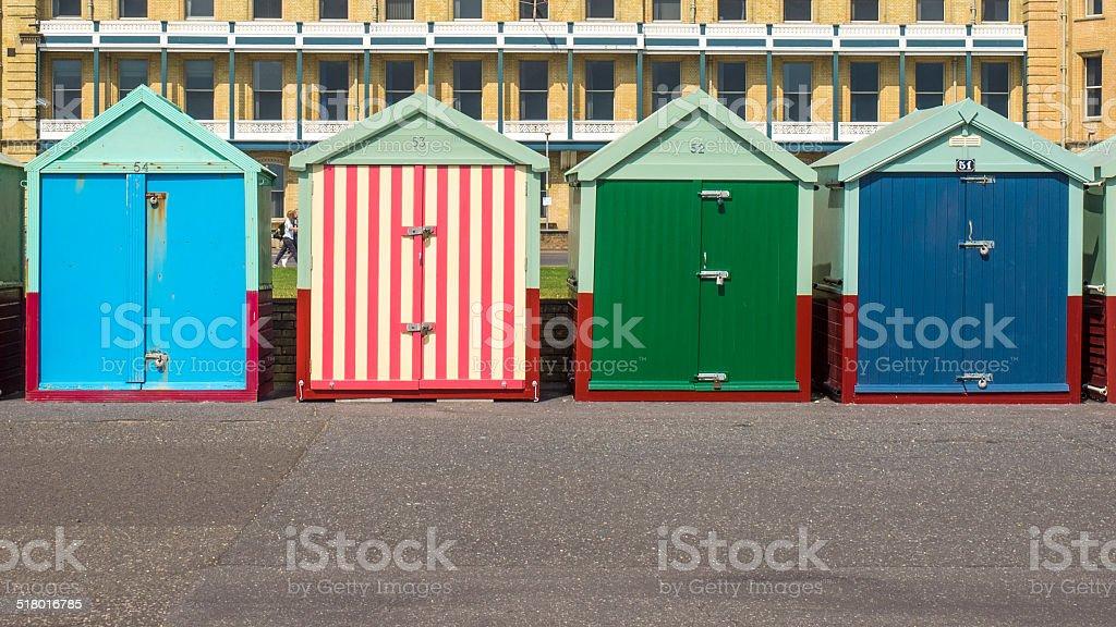 Multi colored beach houses on Brighton boulevard stock photo