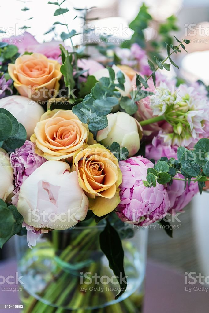 Multi colored bouquet in vase stock photo