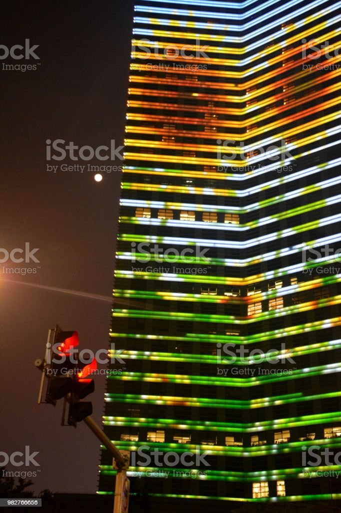 Multi colored building by night in Ningbo, Zhejiang province stock photo