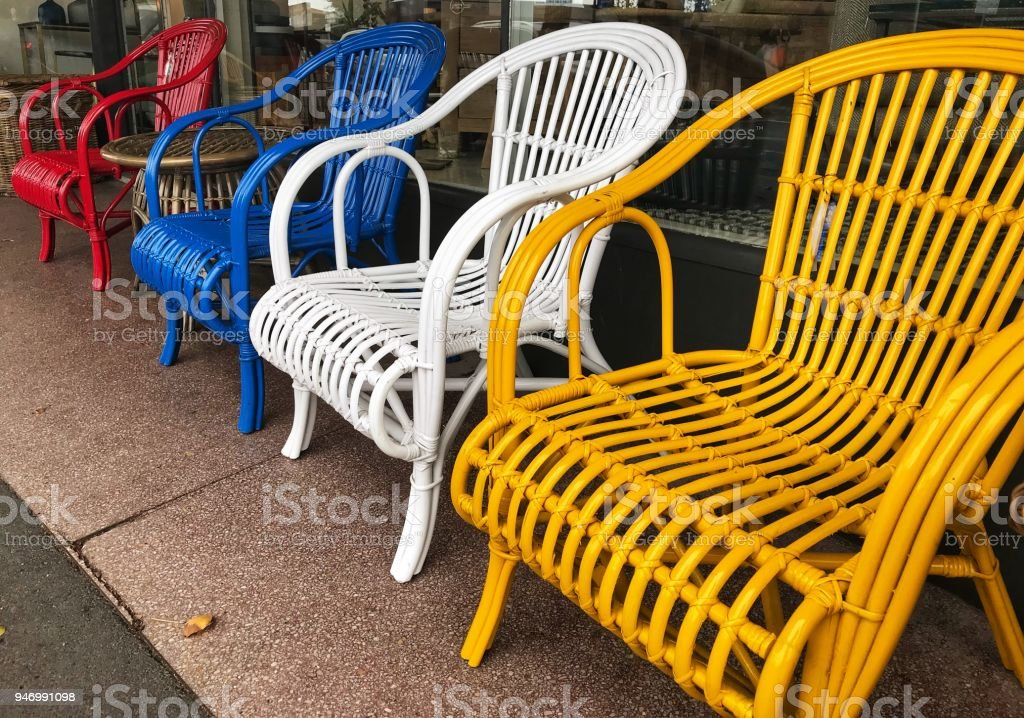 Multi Colored Cane, Wicker Outdoor Chairs In A Row Royalty Free Stock Photo