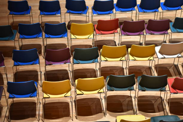 multi colored chairs blue top row - steven harrie stock pictures, royalty-free photos & images