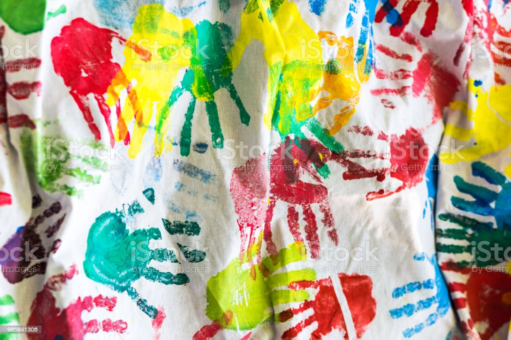 Multi Colored Childrens Handprint Background Stock Photo