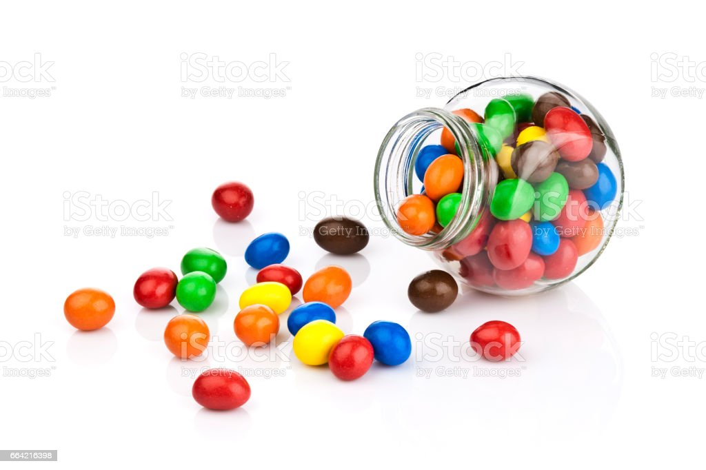 Multi colored chocolate covered candies on white background stock photo