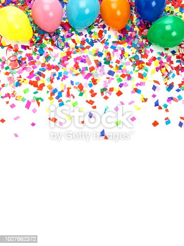 Top view of multi colored paper confetti and balloons background. High key DSRL studio photo taken with Canon EOS 5D Mk II and Canon EF 100mm f/2.8L Macro IS USM.