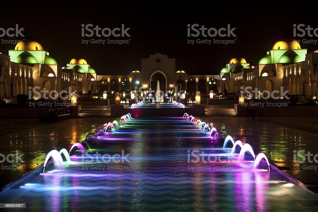 Multi colored fountain design in the dark stock photo