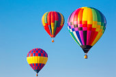 Vivid colored hot air balloons at a balloon festival.  rm