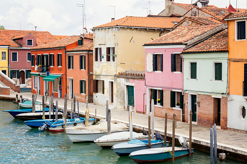 Multi colored houses in Murano at day
