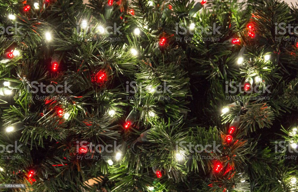 Multi Colored Illuminated Lights On Christmas Tree stock photo