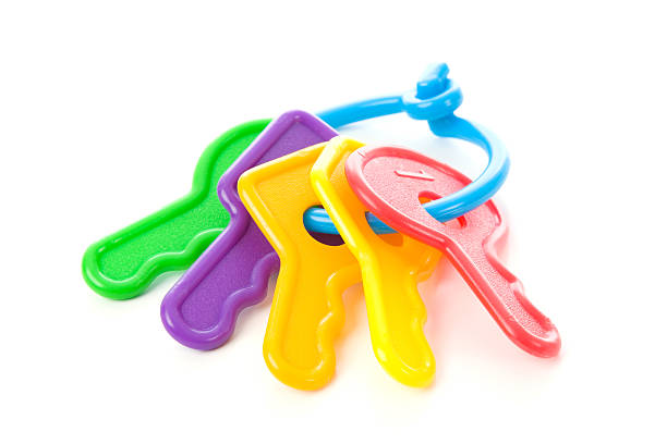 Multi colored keys for a baby stock photo
