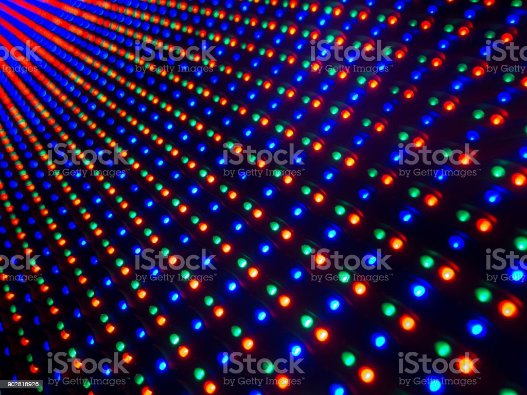 multi colored LED lights screen. Big LED screen with the colours red,green and blue pin lights in a Diminishing Perspective and selective focus stock photo