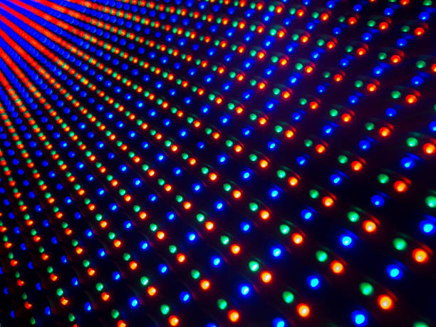 multi colored led lights screen. big led screen with the colours red,green and blue pin lights in a diminishing perspective and selective focus - disco lights stock photos and pictures