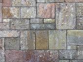 Details of square shape antique stone tiled floor in old building