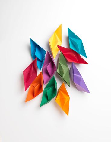 Multi colored Paper Boats - Leadership Concept