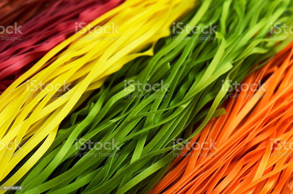 multi colored pasta diagonally horizontal format stock photo