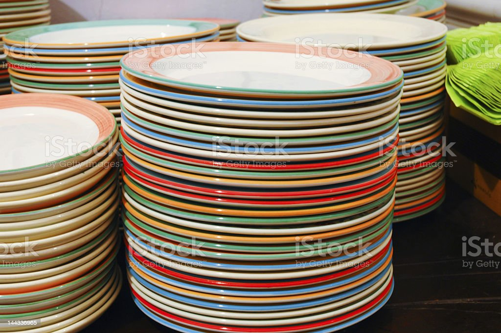 multi colored plates stack royalty-free stock photo