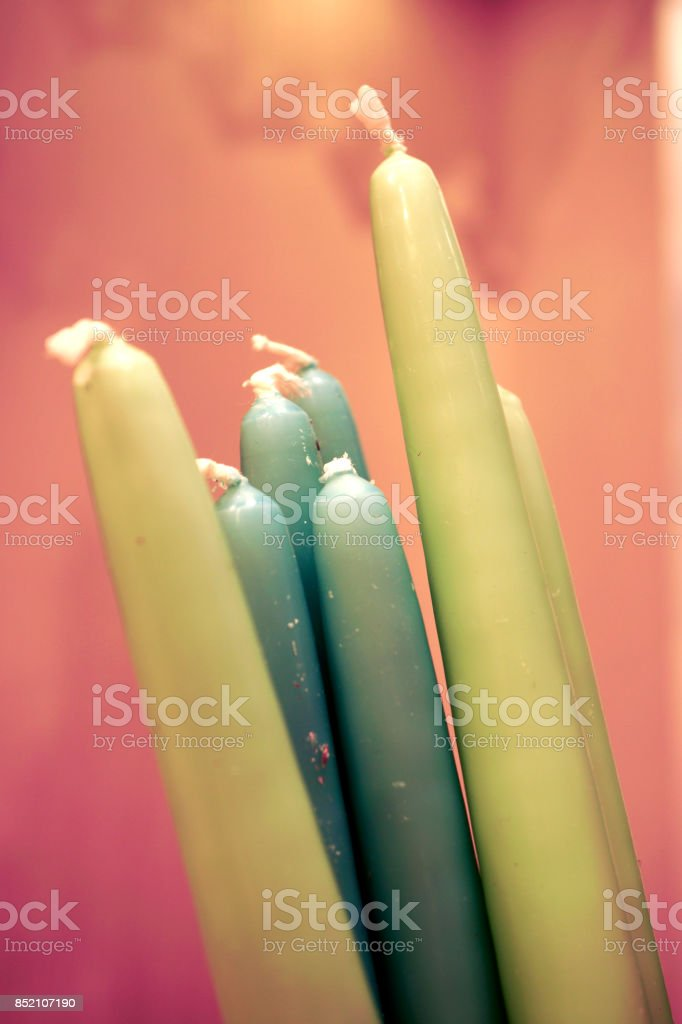 Multi colored pure wax candles background stock photo