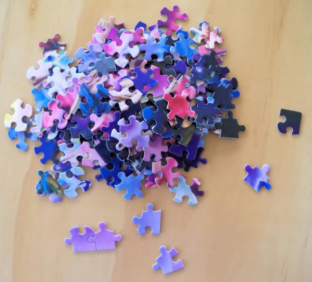 Multi colored puzzle pieces stock photo