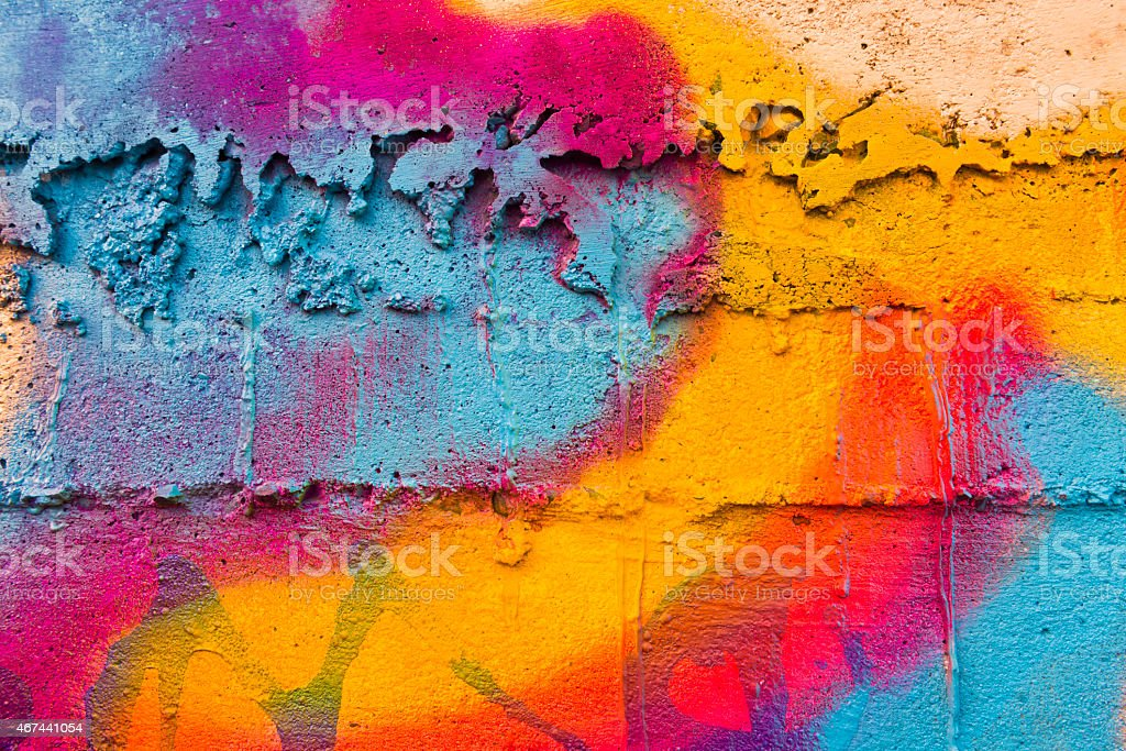 Multi Colored Rainbow Backgrounds of Abstract Graffiti Painted Wall Outdoors stock photo
