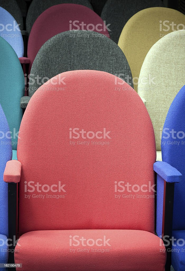 Multi colored seats in an auditorium. royalty-free stock photo