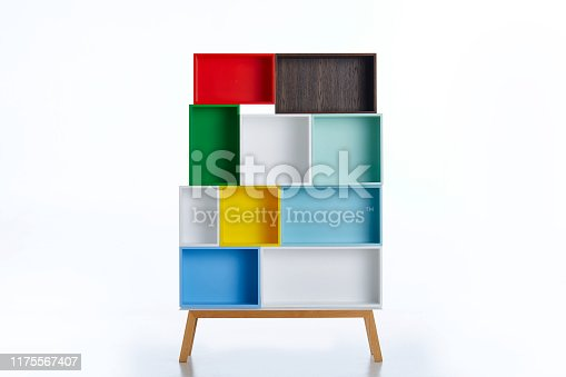 istock Multi colored shelf on white background 1175567407
