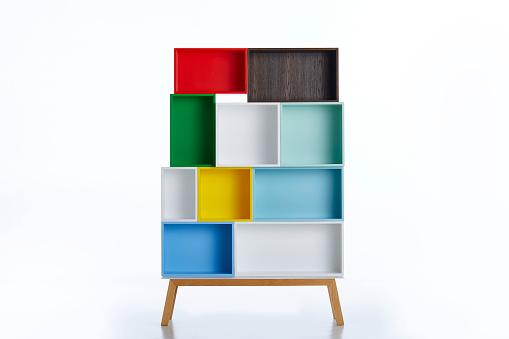 Multi colored shelf on white background