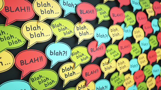 Multi colored speech bubble notes with abstract conversation text