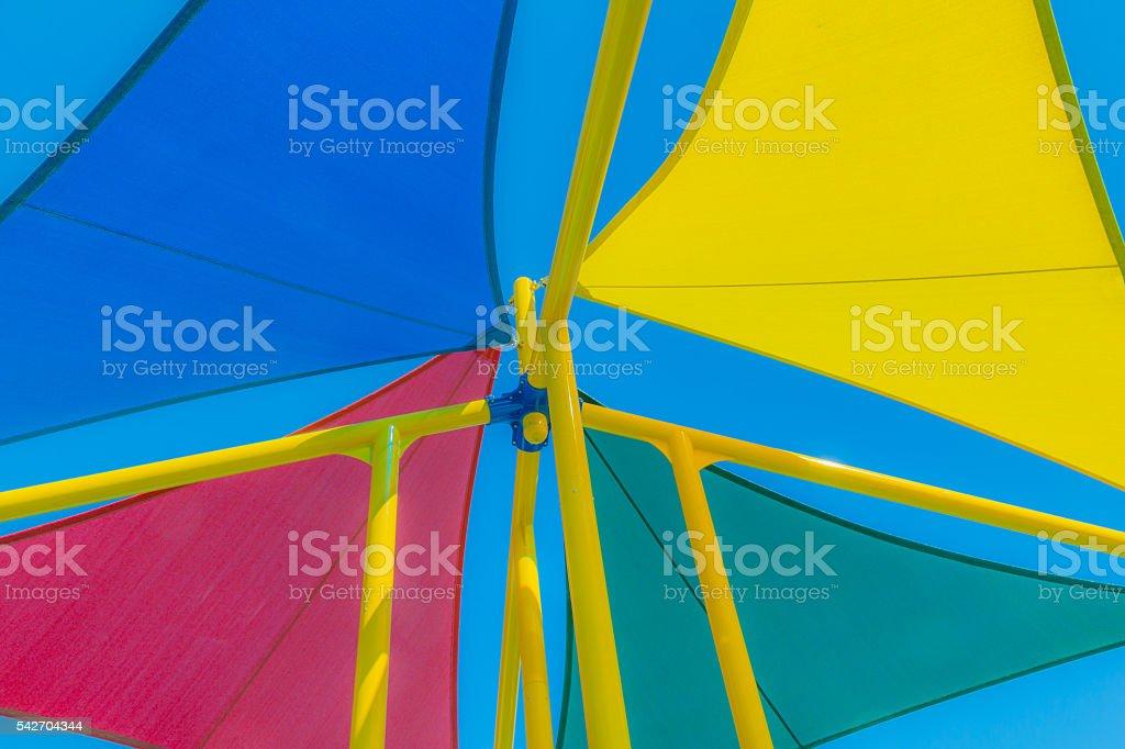 Multi colored sun shades against blue sky, close up (P) stock photo
