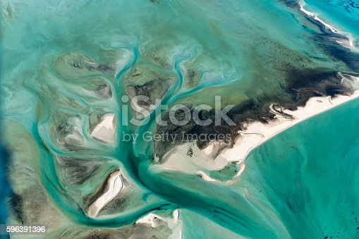 istock Multi Colored Tidal Water Channels Transforming the White Sand Banks 596391396