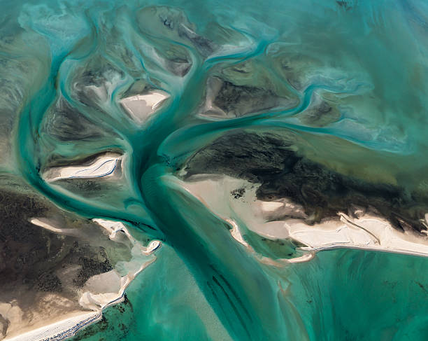 Multi Colored Tidal Water Channels Transforming the White Sand Banks stock photo