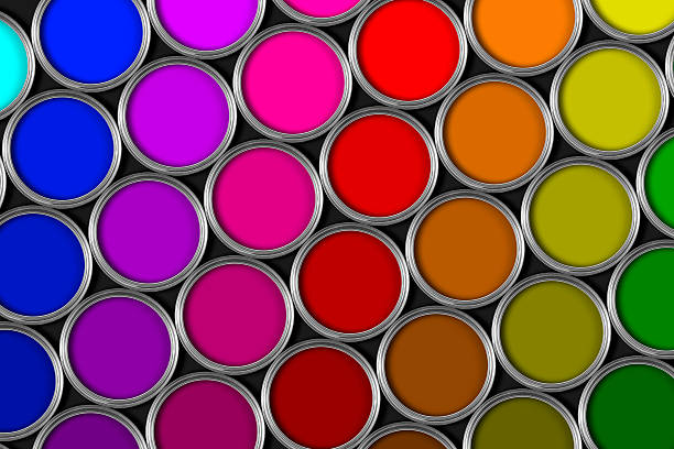 Multi colored tins of paint on black bacground stock photo