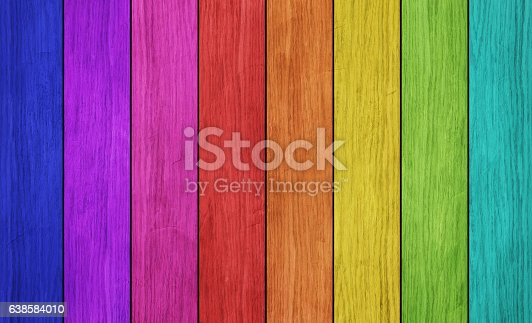 Colorful plank wall in colors of rainbow.