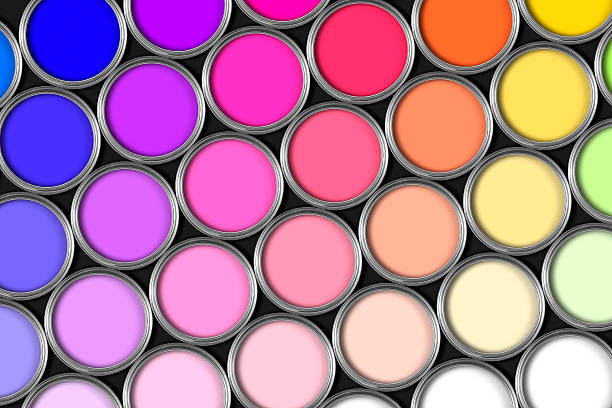 Multi coloured rows of paint tins on black stock photo