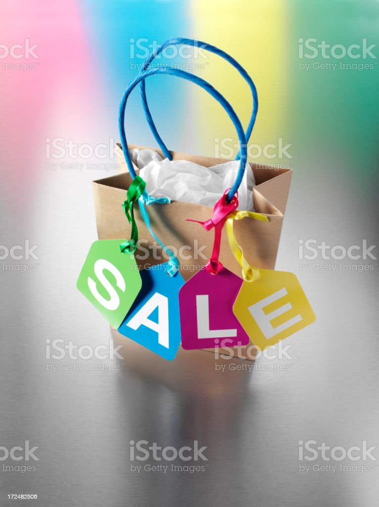 Multi Coloured Sale Label on the Brown Carrier Bag royalty-free stock photo