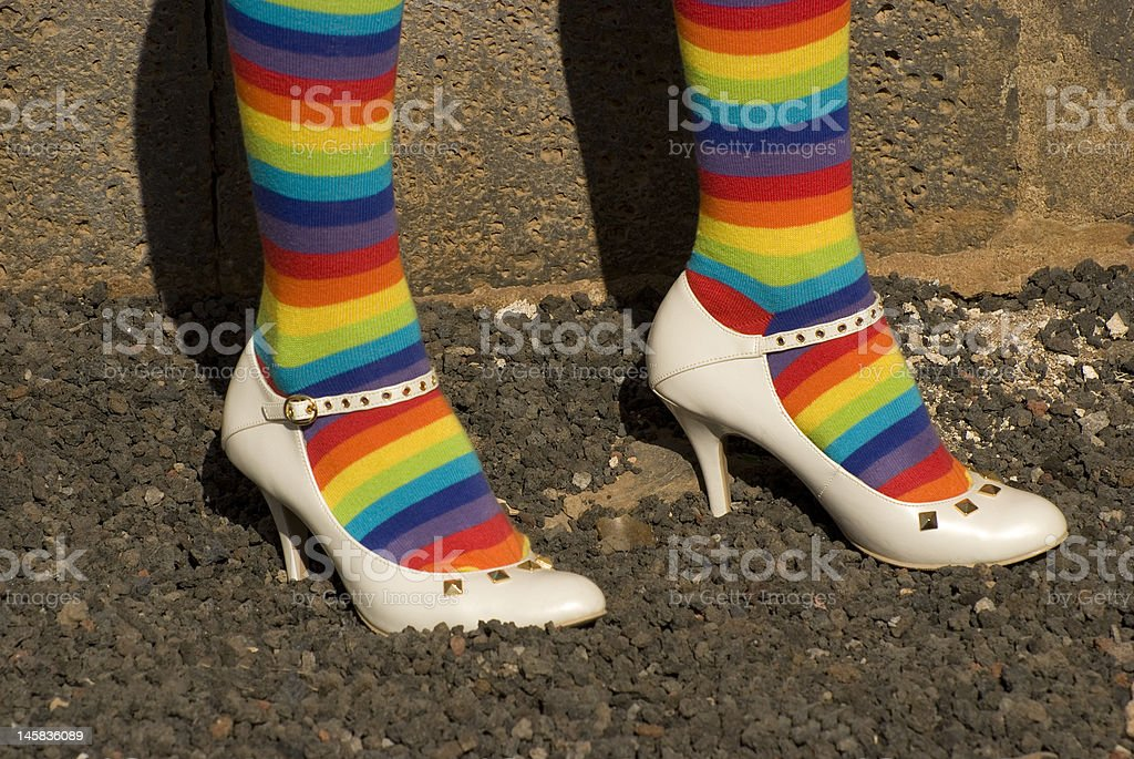 multi coloured socks with white shoes royalty-free stock photo