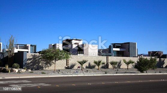Residential Condominium complex behind wall.