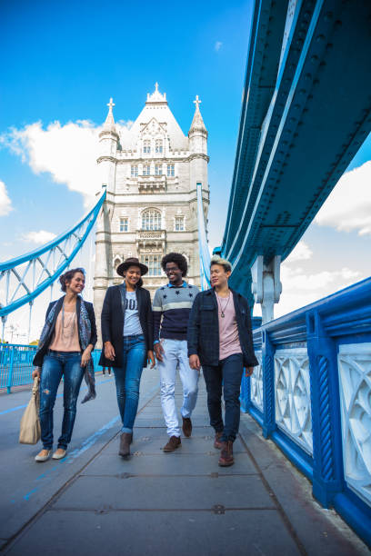 Multi cultural group of friends hanging out in Central London, on the Tower Bridge. Multi cultural group of friends hanging out in Central London, on the Tower Bridge. central london stock pictures, royalty-free photos & images