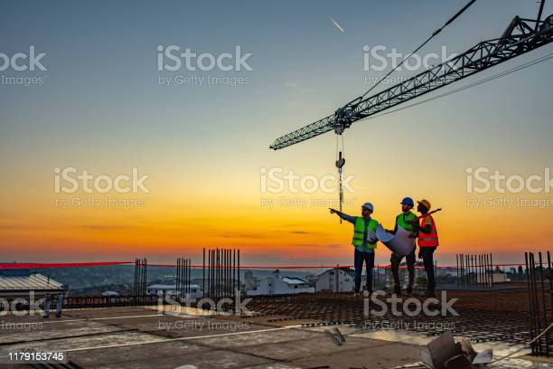 Multi ethic workers talking at construction site reviewing plans picture id1179153745?b=1&k=6&m=1179153745&s=612x612&h=o w7nhzp2zhrlytryiq4d2mjr7edhiadai 1noj8qjk=