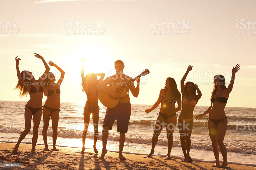 Multi ethnic beach party royalty-free stock photo