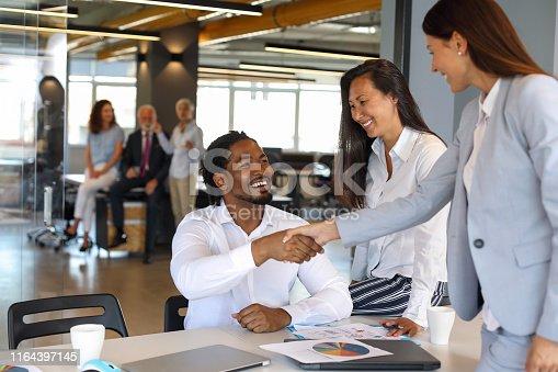 Colleague greeting, handshake.