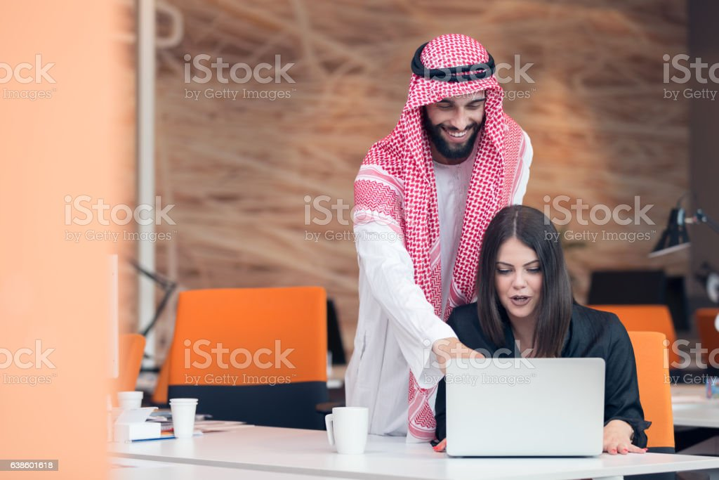Multi ethnic business people at work in modern startup office stock photo