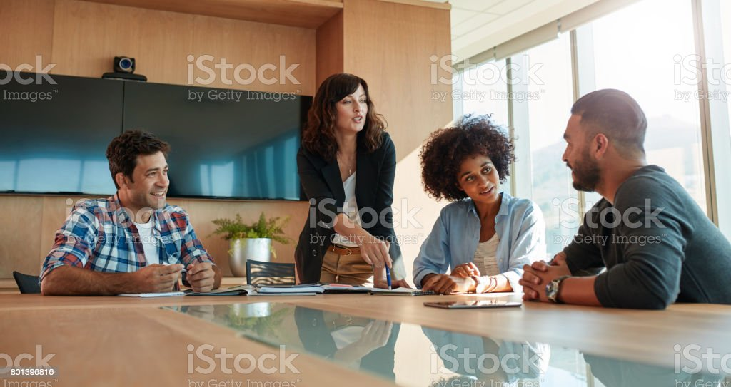 Multi ethnic business team during meeting in office stock photo