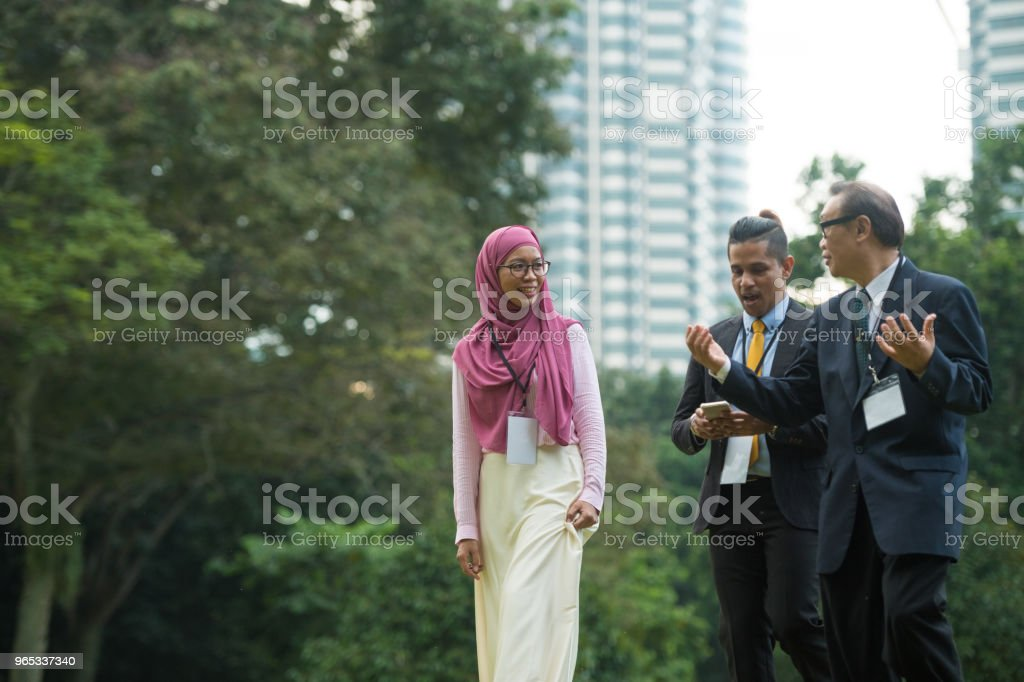 Multi ethnic business team having a walking meeting royalty-free stock photo