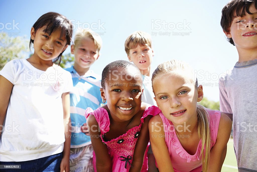 Multi ethnic children giving you cute smiles royalty-free stock photo