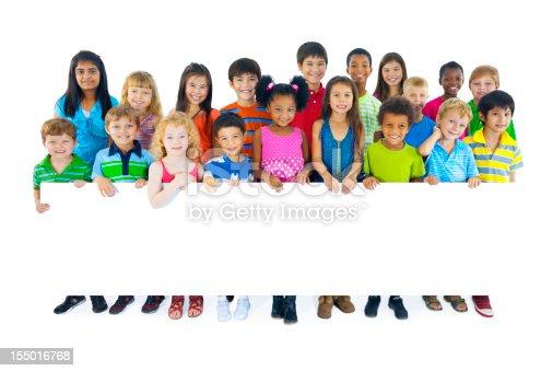 istock Multi ethnic children holding a blank placard 155016768