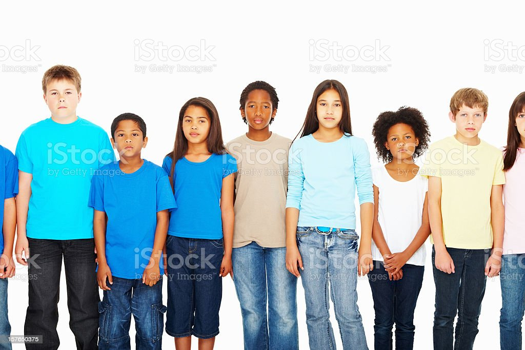 Multi ethnic children standing in a row against white background royalty-free stock photo