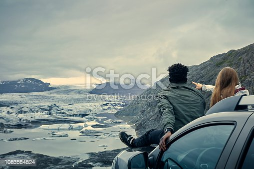 Couple relaxing during road trip. Looking at view