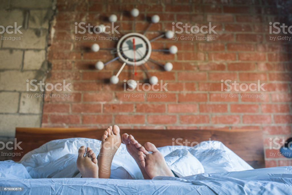 Multi Ethnic Couple in Bed stock photo