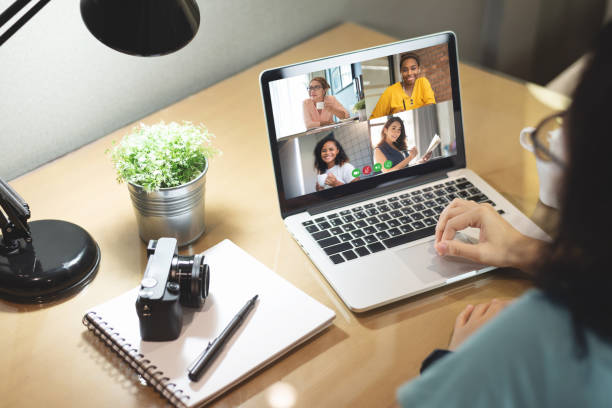Multi ethnic Diversity Women make video call for business on laptop stock photo