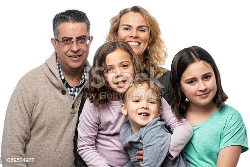 Multi ethnic Family of five posing together on white background