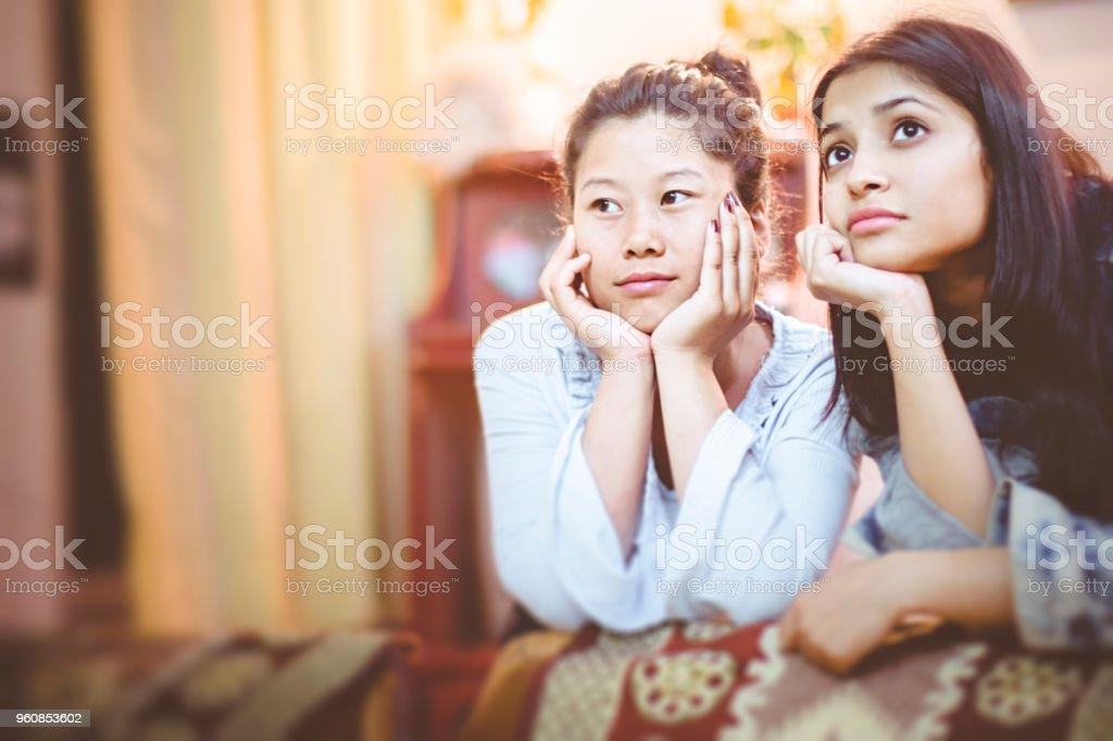 Multi ethnic female friends at home. stock photo